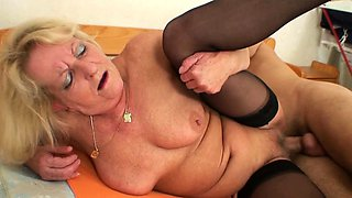 Old blonde granny in stocking spreads legs for him