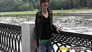 Piss-drenched babe in glasses in public