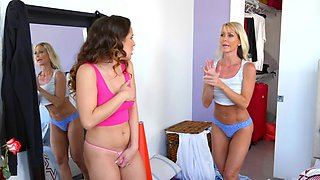 Blonde MILF tempts stepdaughter into world of lesbian sex