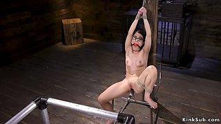 Gagged slave in bondage fucks machine