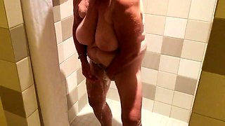 Chubby brunette granny flaunts her sexy body in the shower