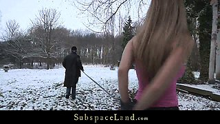 Cruel dominator spank his slave out in cold