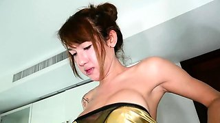 Awesome asian ladyboy in gold clothes gets fucked hard