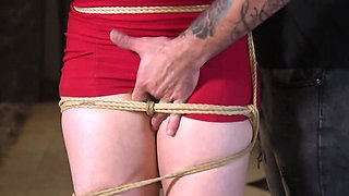 Tied up hostage is forced to have anal sex with a dominant guy