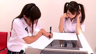 Naughty Japanese schoolgirls show off their lovely titties