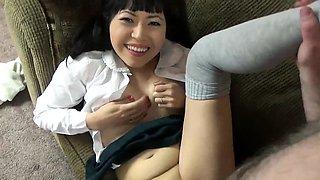 Asian housewife Yuka Ozaki opens her shirt to show off her