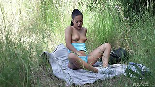 Handsome chick Apolonia Lapiedra playing with her pussy in the woods