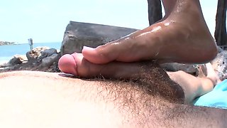 Sweet brunette gal gives a perfect footjob to her boyfriend