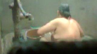 big beautiful woman indian bhabhi taking shower from pump