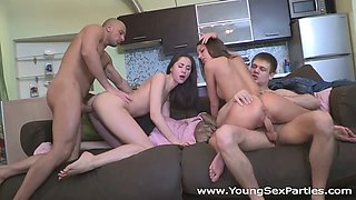 Two dark-haired chicks get fucked in many poses in a foursome