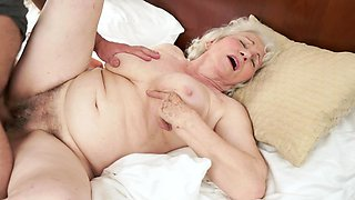 Fat old granny is getting her wet cunt fucked really hard