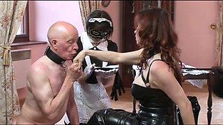 Older slut uses submissive males as her slaves