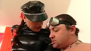 Domme in latex and pvc high boots wants his spunk over her boots