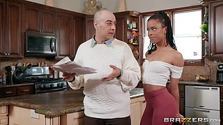 Ebony petite maid Kira Noir swallows her boss's cum in the kitchen
