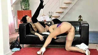 Lesbians in fishnet and stockings tease each other