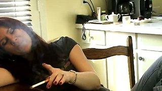 Brunette slut rubbing her tits while smoking
