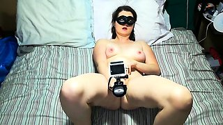 Masked amateur brunette with lovely tits fucks a big toy