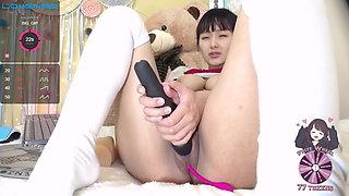 Asian in schoolgirl uniform squeezes milk from big tits