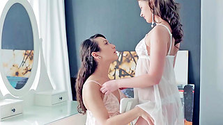 Two girls are having lesbian action in a threesome