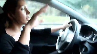 Attractive brunette delivers a fabulous handjob in the car