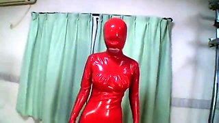 Kinky Japanese babe in latex is made to cum with a vibrator